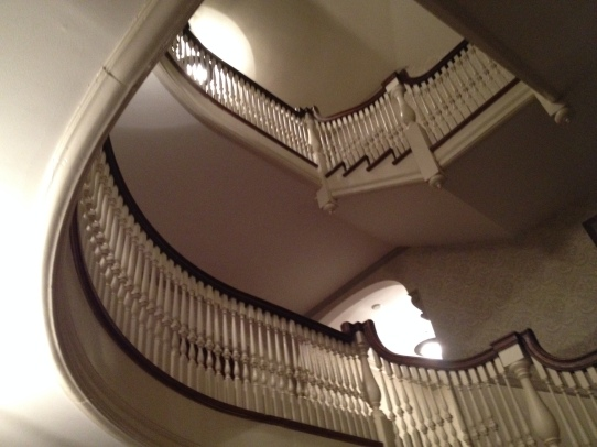 Looking up the stairs to the second and third floors.