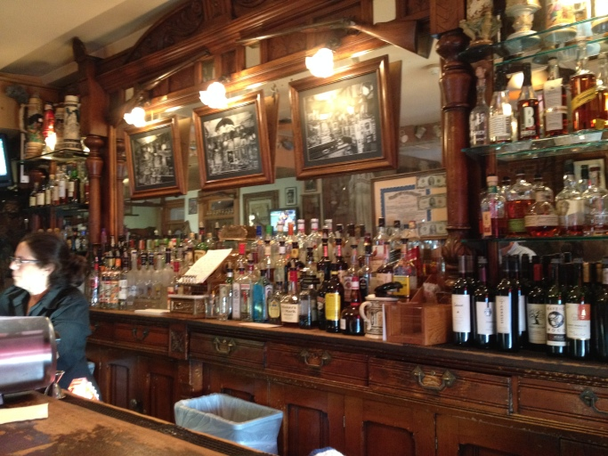 "The ornate white oak bar and back-bar, made in Essen, Germany in 1857 and brought here by the the family of the original owner, Henry H. ""Shorty Scout"" Zietz."
